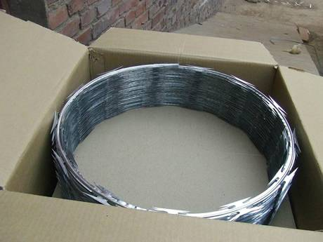 Concertina barbed wire coils packaged in carton box.